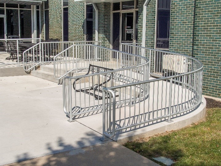 Curved aluminum railing provides a natural flow and is used to creat a curved handrailing