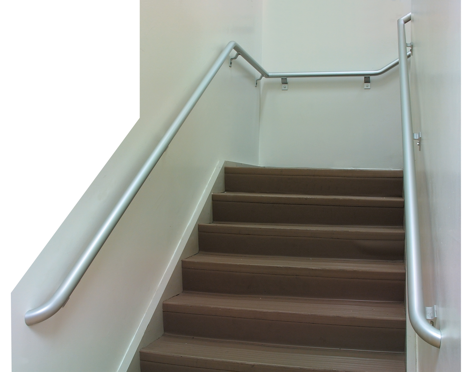Pipe handrail on both sides of an interior stairway