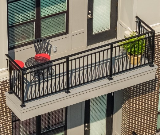 Series 9100 Architectural Railing anchored using surface mount on a balcony.
