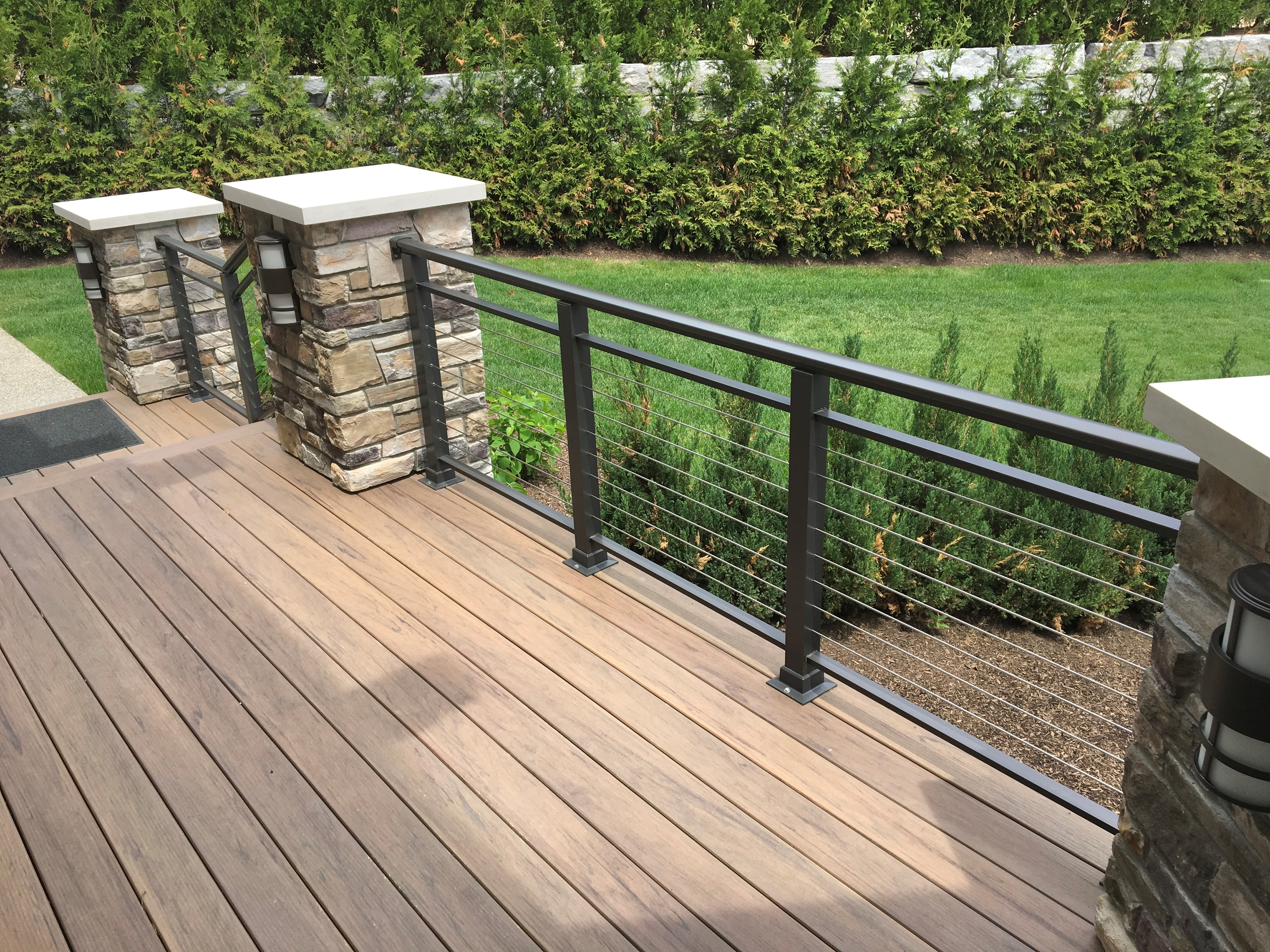 A residential home features deck cable railing