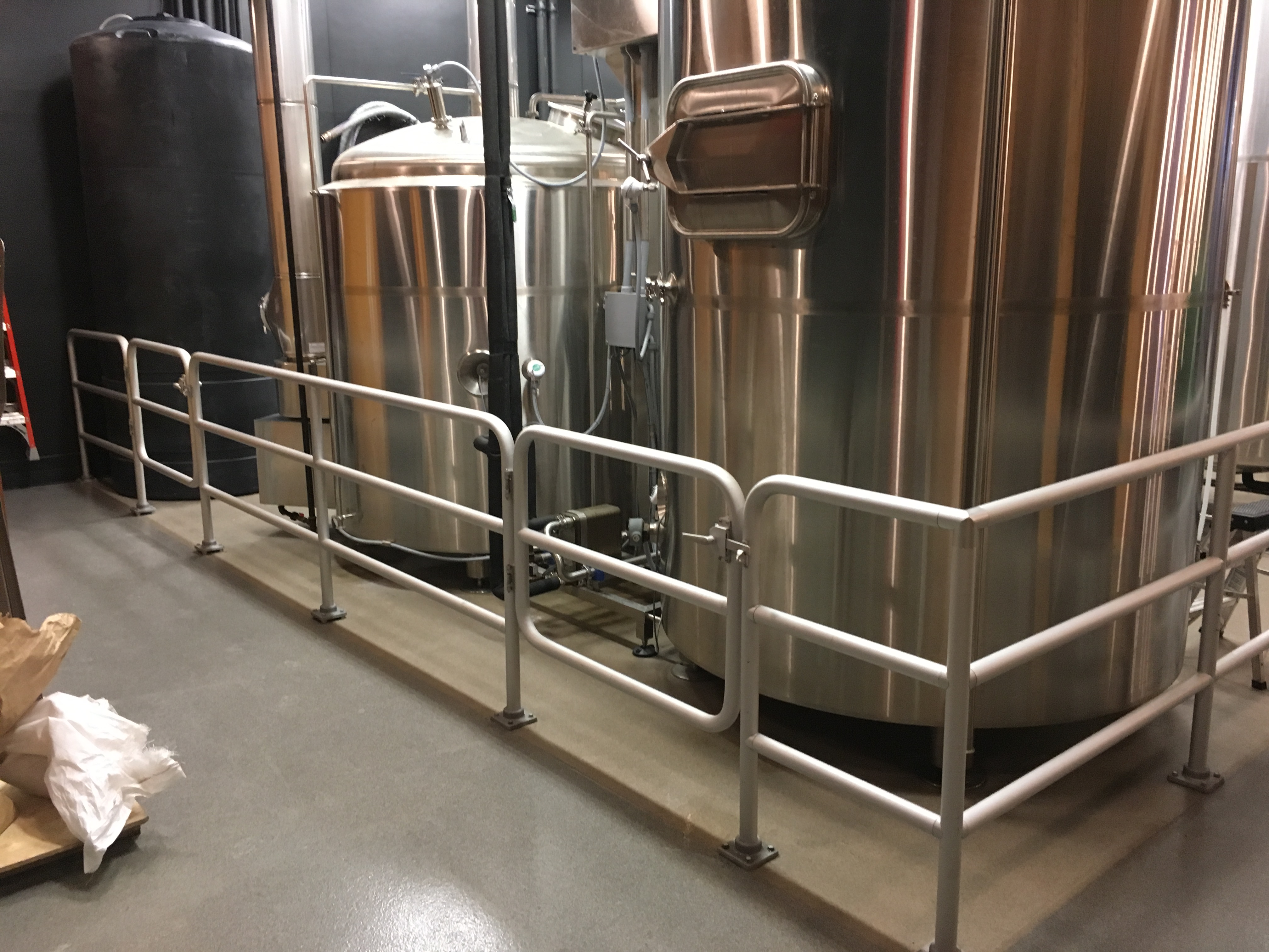 Pipe railing guards the tanks of an Ohio craft brewery