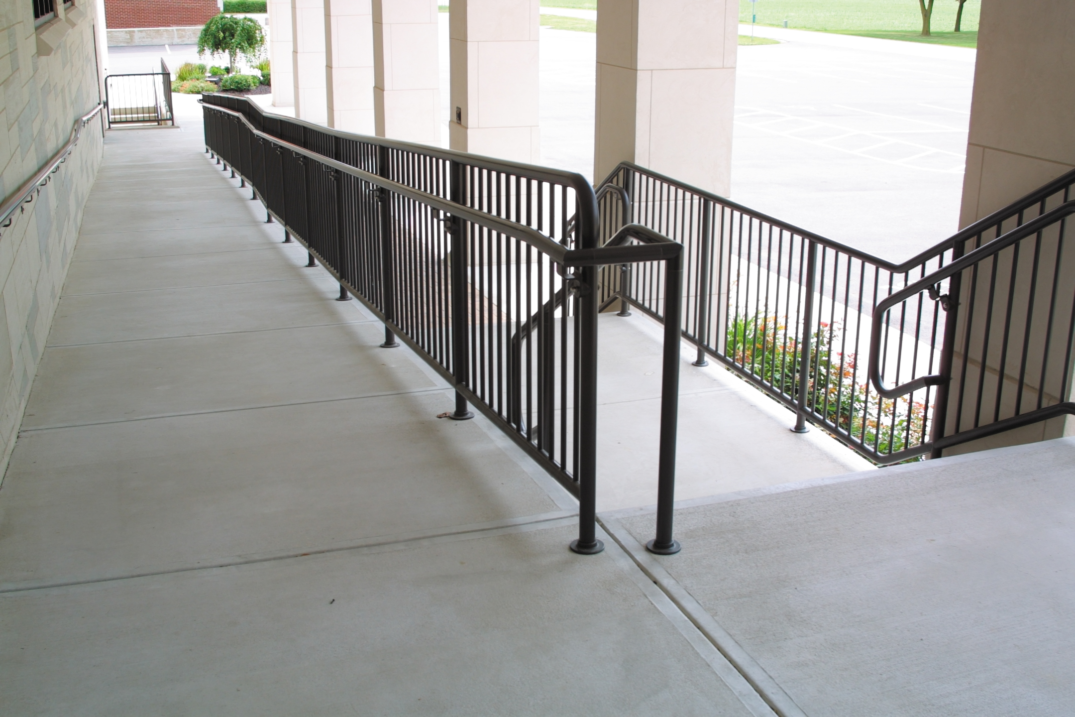 An Ohio church with pipe picket railing and pipe handrail to assist in travel up a ramp
