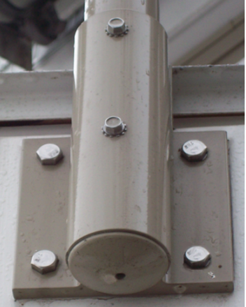 Close up of a side mount anchored into a building.